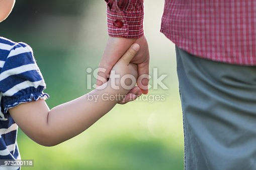 Little baby pulling parents hand