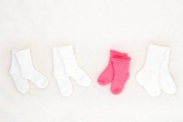 little baby socks from above - studio shot stock photo