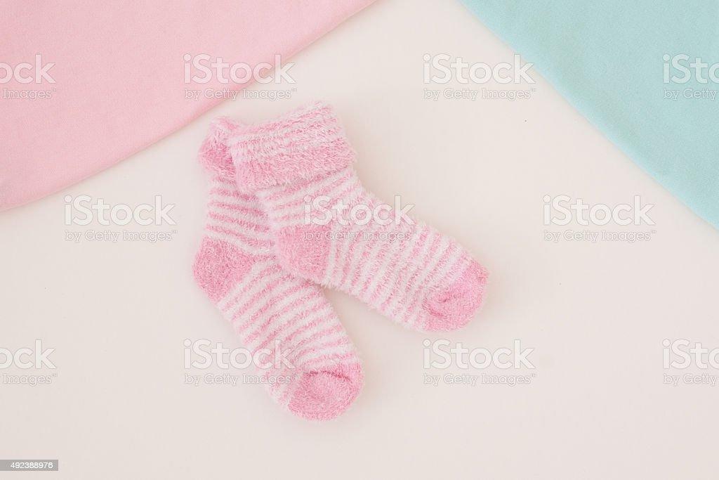 little baby socks on white background - studio shot stock photo