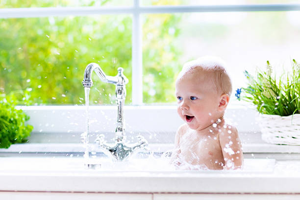 little baby taking bath - baby bathtub bildbanksfoton och bilder
