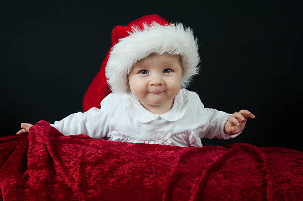Royalty Free Black Baby Wearing A Christmas Hat Pictures Images And