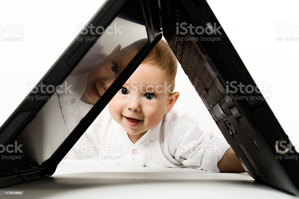 Little baby with laptop. royalty-free stock photo