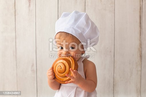 istock Little baker cook 1208434862