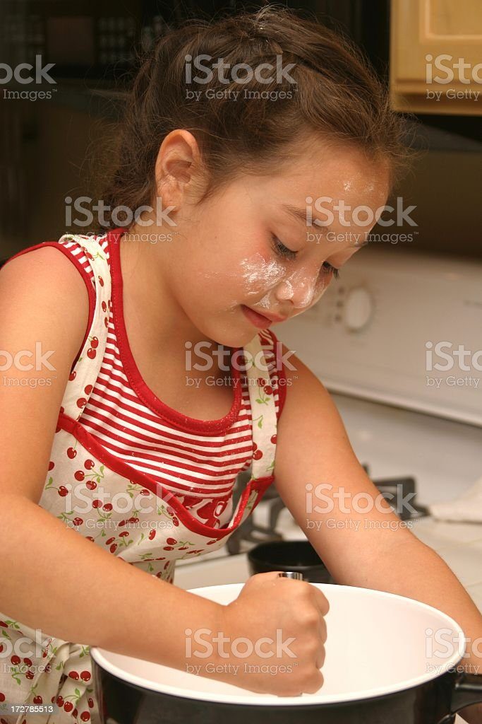 Little Baker Girl with Flour on Face royalty-free stock photo