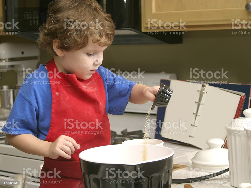Little Baker Pours Brown Sugar royalty-free stock photo