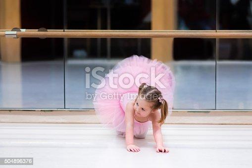 istock Little ballerina at ballet class 504896376