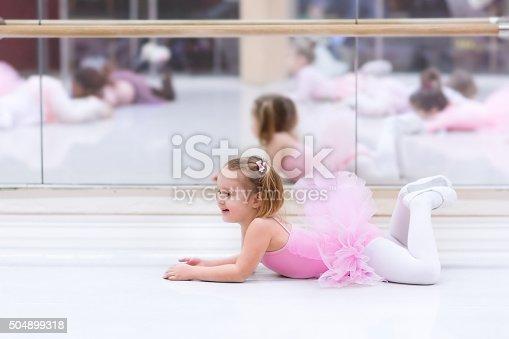 istock Little ballerina at ballet class 504899318