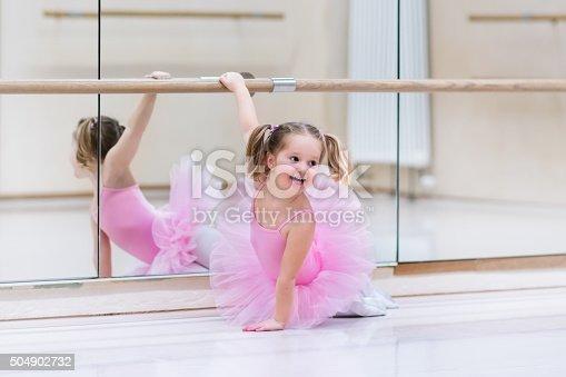 istock Little ballerina at ballet class 504902732