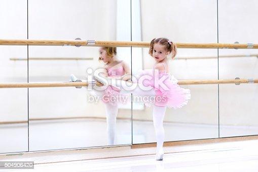 istock Little ballerina at ballet class 504906420
