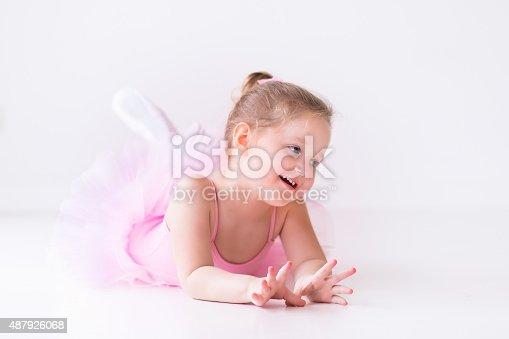 istock Little ballerina in pink tutu 487926068