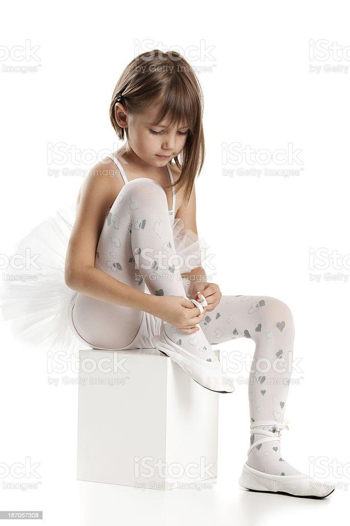 Little ballerina in stockings preparing for dance stock photo
