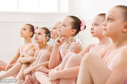 istock Little ballerinas in ballet studio 813634084