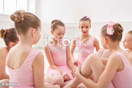 istock Little ballerinas talking in ballet studio 813634014