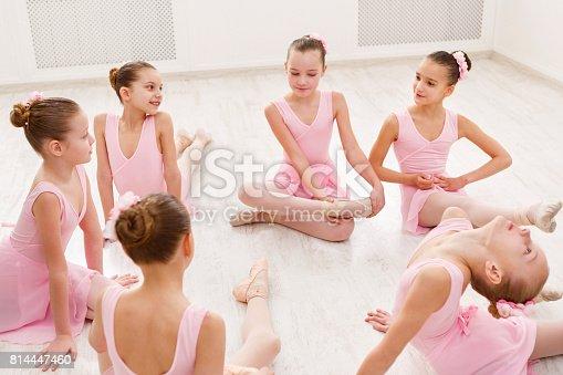 905560090 istock photo Little ballerinas talking in ballet studio 814447460