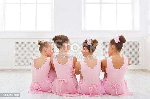 istock Little ballerinas talking in ballet studio 814447708