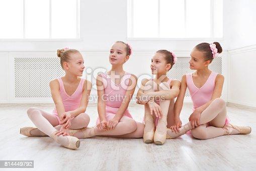 905560090 istock photo Little ballerinas talking in ballet studio 814449792