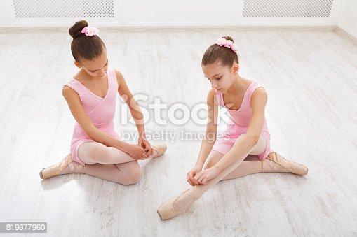 905560090 istock photo Little ballerinas talking in ballet studio 819677960