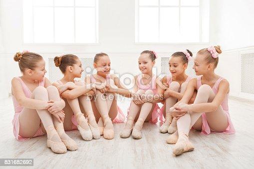 819677734 istock photo Little ballerinas talking in ballet studio 831682692