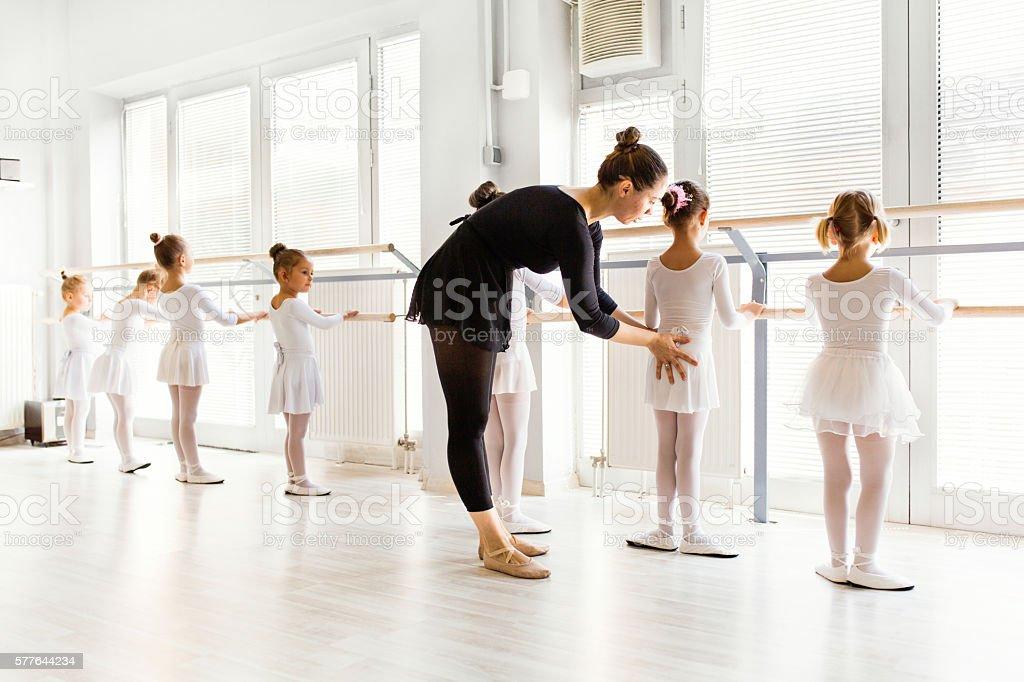Little ballerinas with personal ballet teacher in dance studio. - foto de acervo