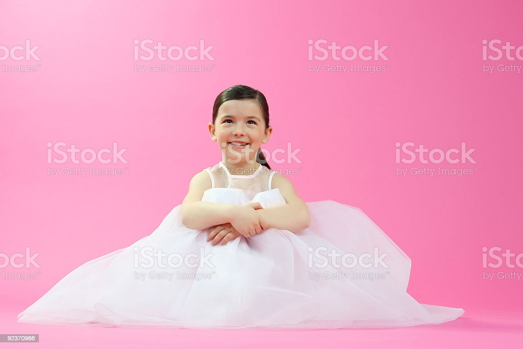 Little ballet dancer on a pink background royalty-free stock photo