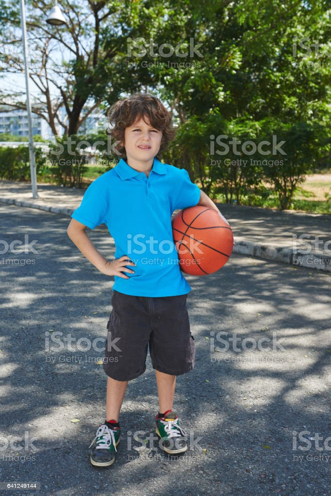 Little basketball player in park stock photo