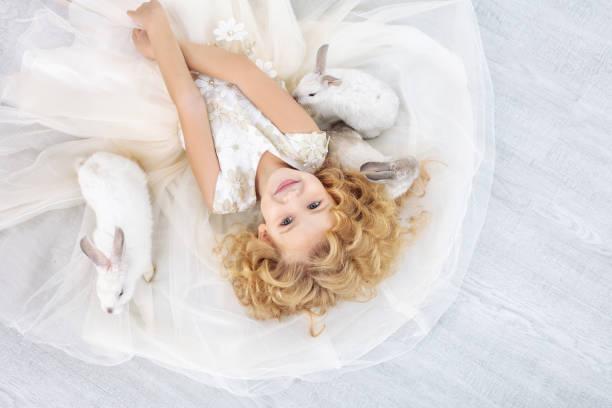 Little beautiful and cute girl in a trendy festive dress with animals picture id1144287762?b=1&k=6&m=1144287762&s=612x612&w=0&h= spg1mqwx21n0xfohcmpepcu3p cnk5 m5mddeo9bta=