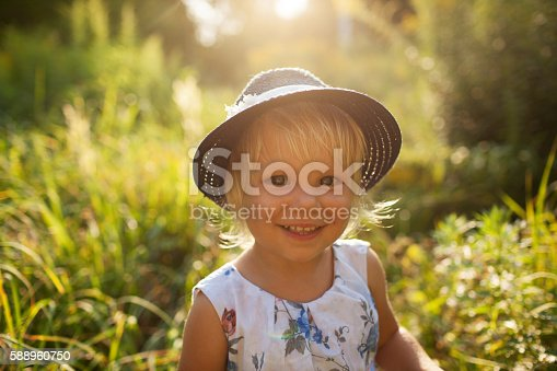 istock .Little beautiful girl in a hat 588960750