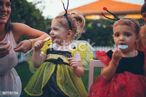 istock Little bee and lady bug having some Halloween candy 607731734