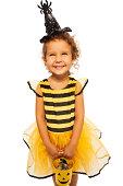istock Little bee costume with candy Halloween bucket 513254823
