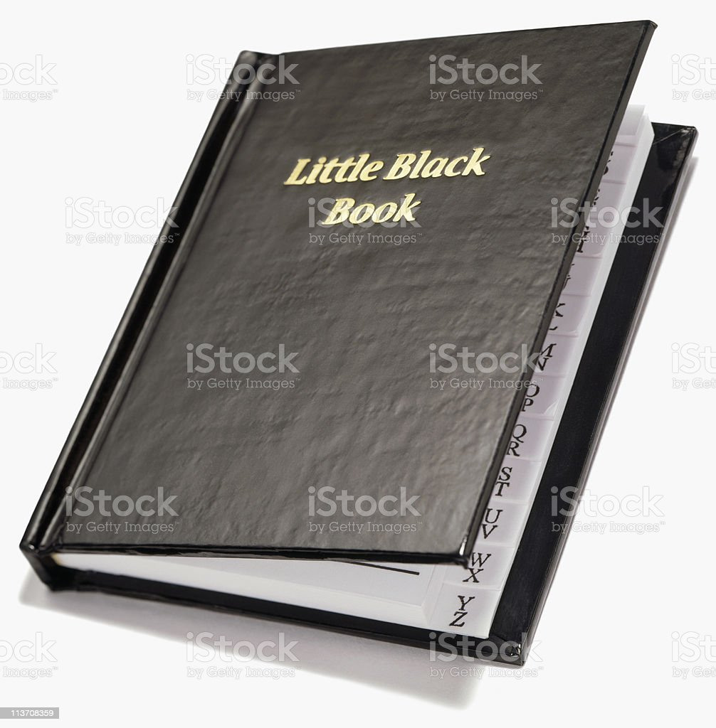 little black book cut out on white stock photo