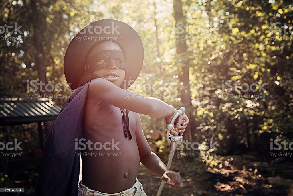 Little black boy costumed playing outside. stock photo