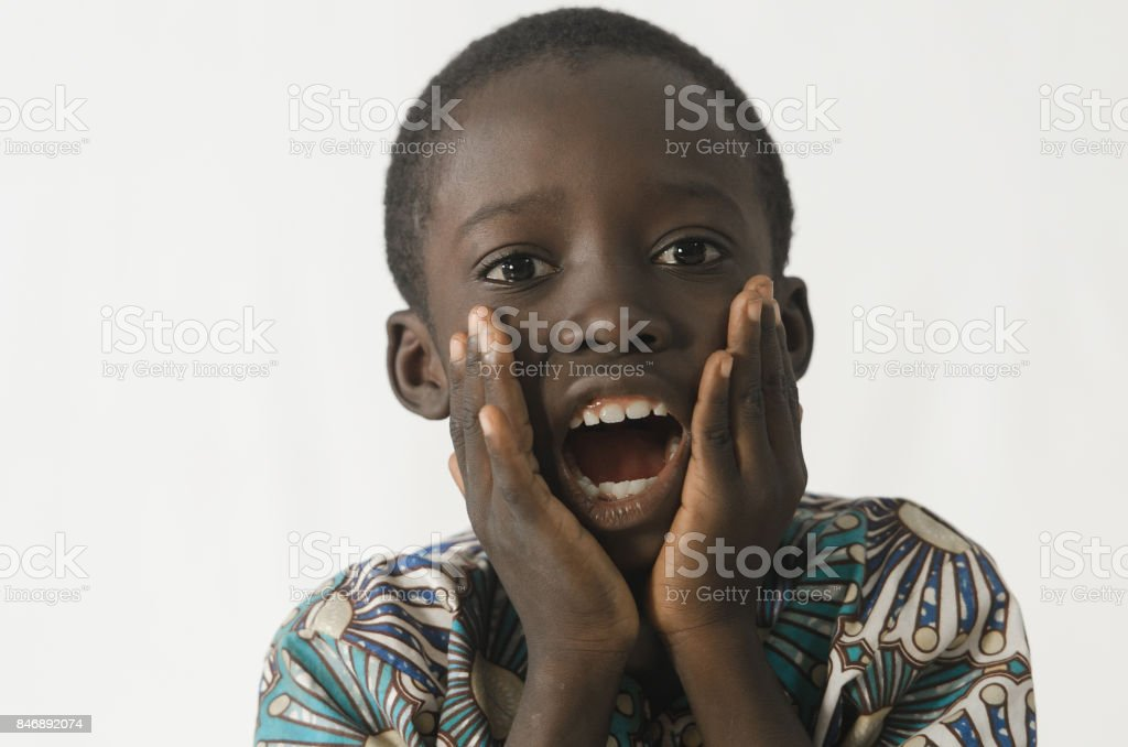 Little black boy surprised and excited with white isolated background stock photo