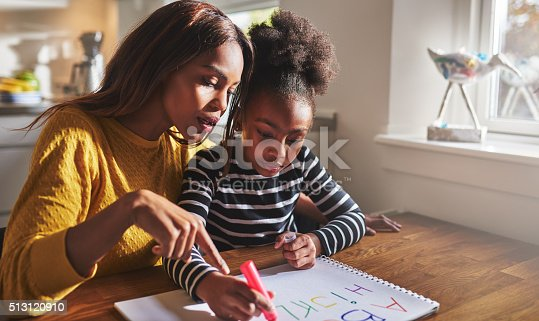 istock Little black girl learning to read 513120910