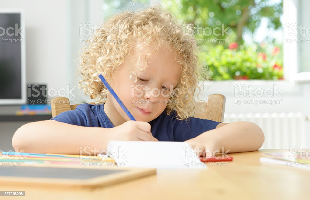 little blond boy drawing in his home royalty-free stock photo