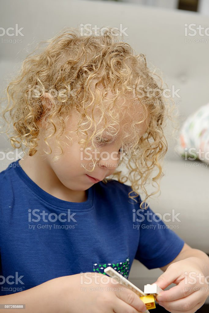 little blond boy playing with toys Lizenzfreies stock-foto