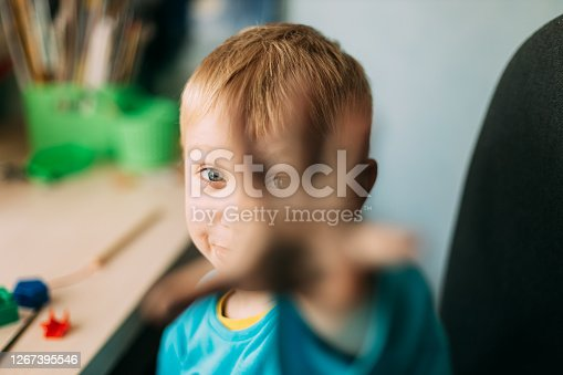Little Blond Boy Shows His Hand Stained With Paint.