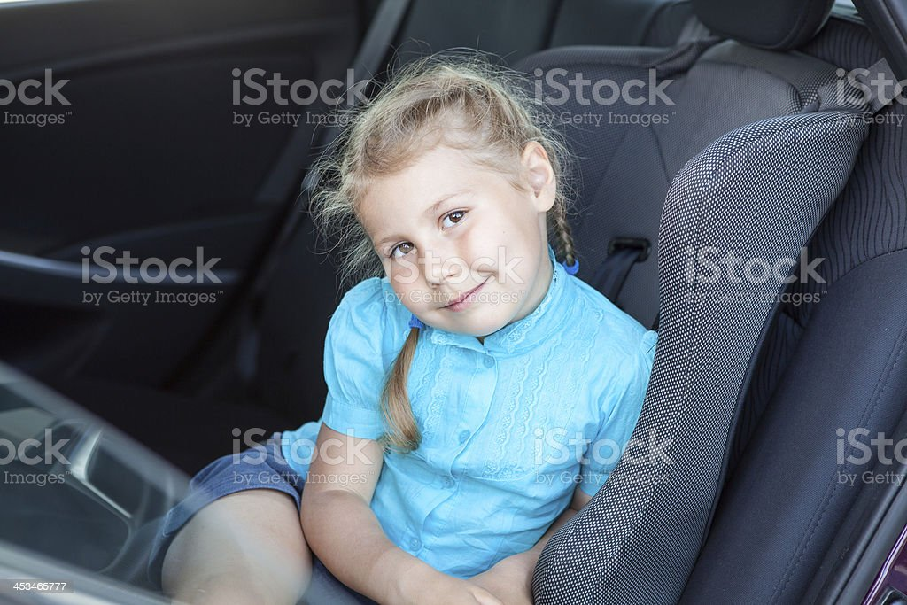 fa6e790b348 Little Blond Girl In Car Safety Seat Going To Journey Stock Photo ...