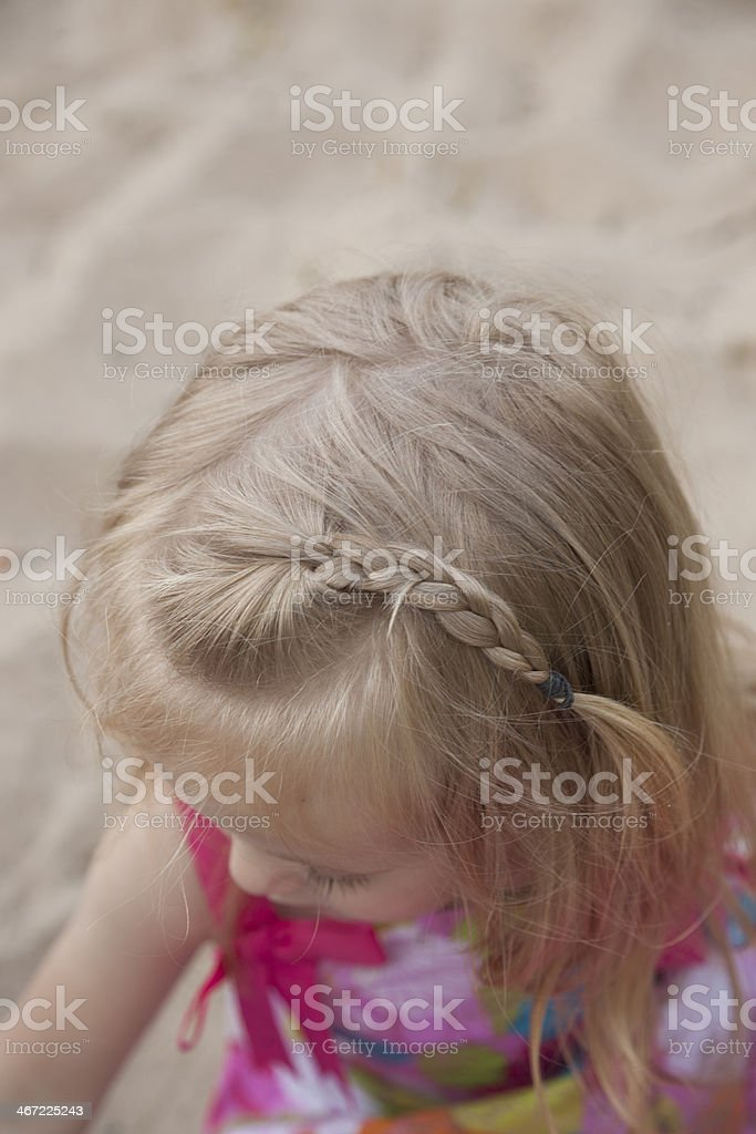Little blond Girl with braid in her hair on beach royalty-free stock photo