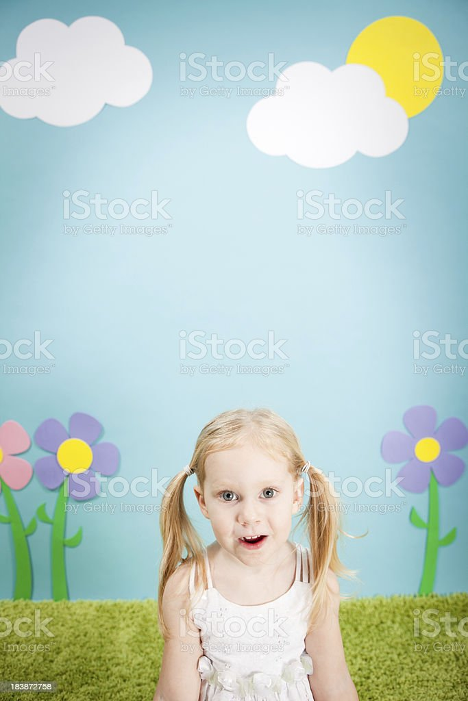 Little Blond Girl with Look of Surprise in Whimsical World royalty-free stock photo