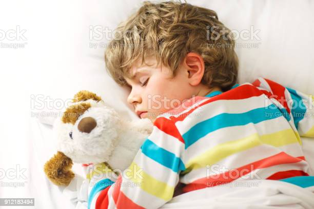 Little blond kid boy in colorful nightwear clothes sleeping picture id912183494?b=1&k=6&m=912183494&s=612x612&h=kth4h5ikz2gqg2br9 rvgxpnd9xh9g9hvnrmbqyysmg=