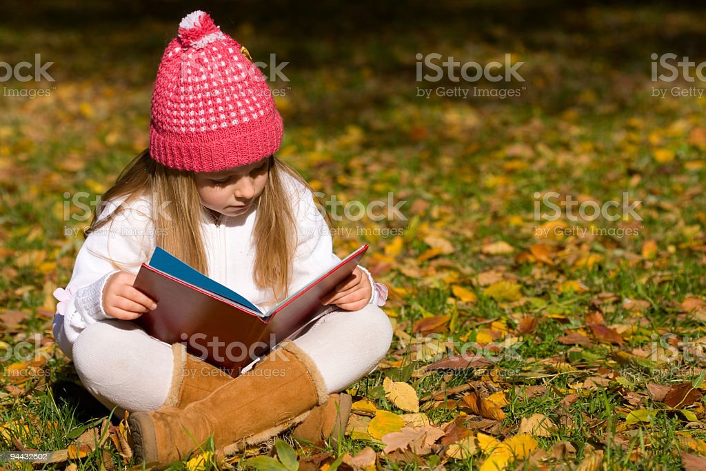 Little blonde girl read book royalty-free stock photo