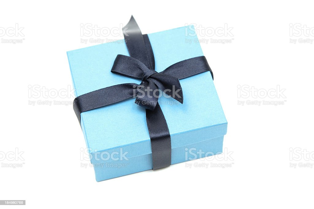 Little blue gift box with a dark ribbon stock photo