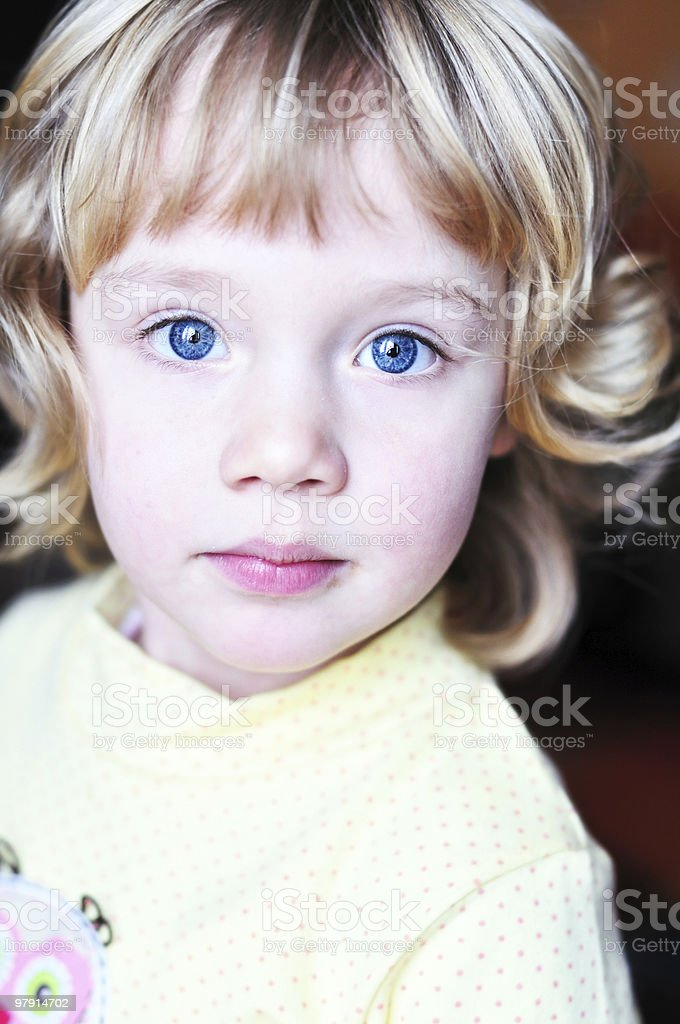 little blue-eyed pretty girl royalty-free stock photo