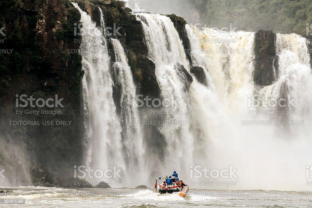 Little Boat Aproaching Iguazu Falls stock photo