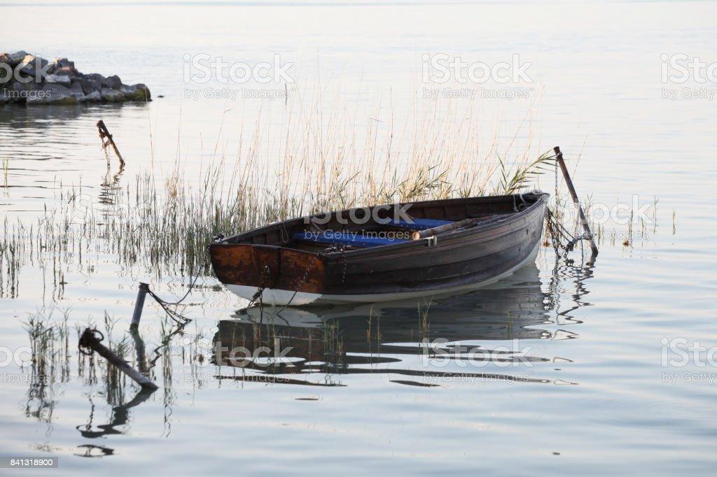 Little boat in a bay stock photo