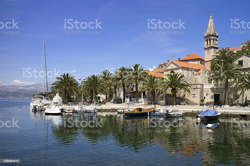 Little boats and old stone houses stock photo