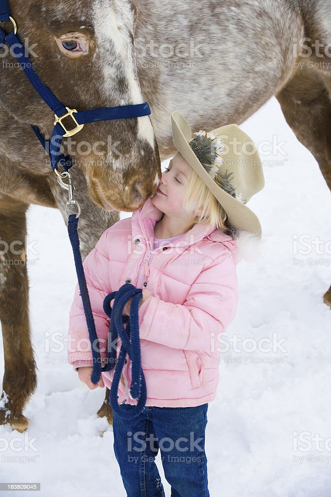 Little Bonde Girl Kissing Big Horse, Nuzzled by an Appaloosa stock photo