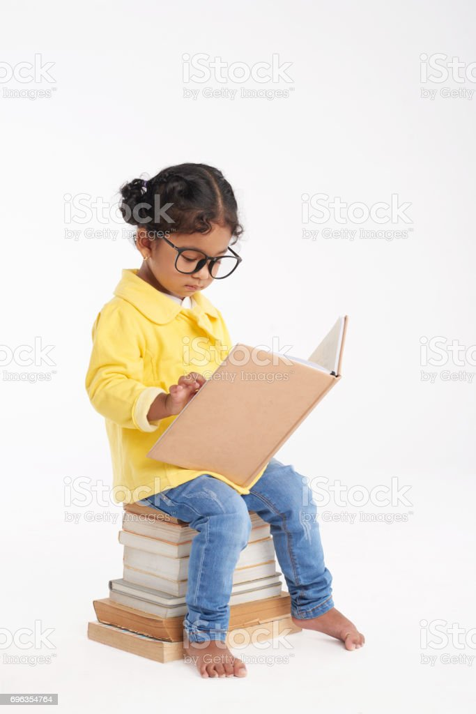 Little Bookworm Wrapped up in Reading stock photo