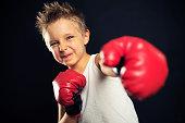 Little boy playing boxer.