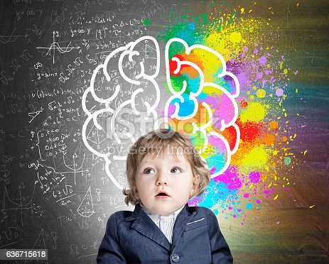 istock Little boy and a colorful brain sketch 636715618